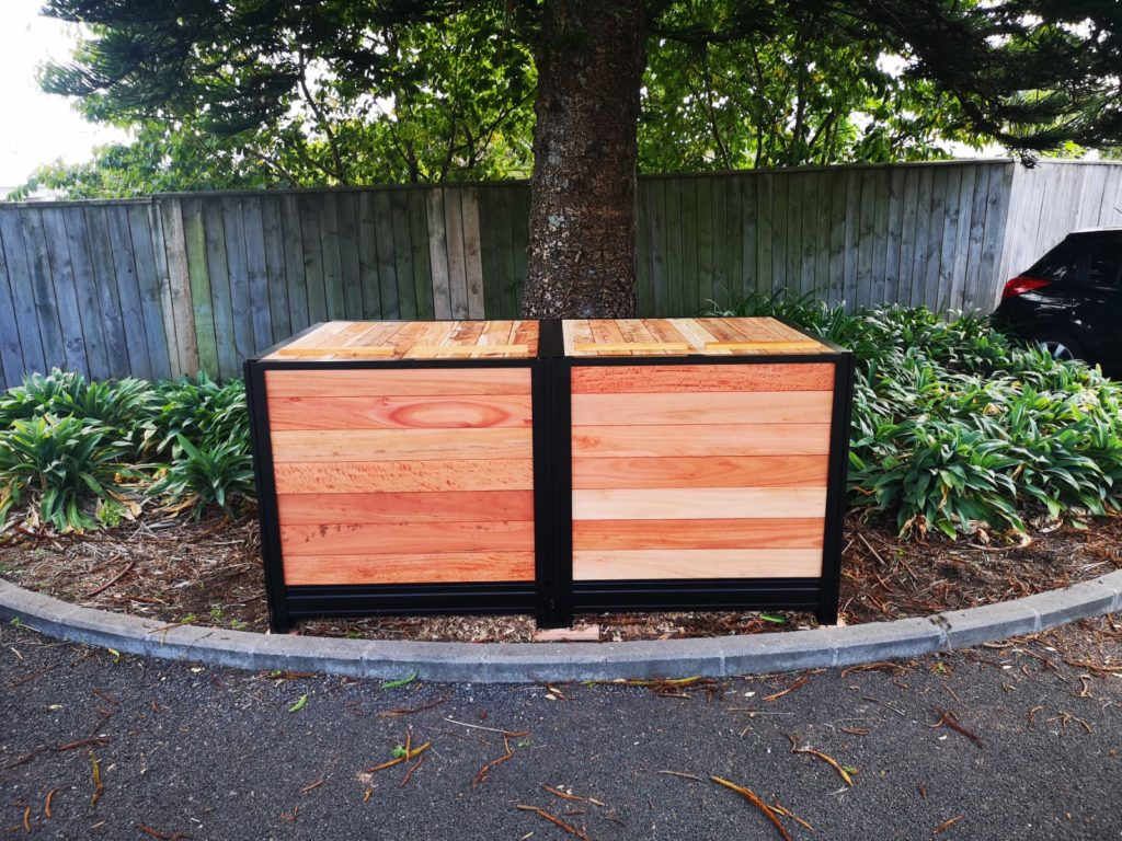 Two compost bins side by side outside to show where to place your composters